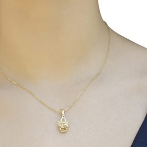 Noemi Flora Basket 18ct Gold Pendant Charm With A Gold Chain Around A Model's Neck