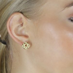 Noemi Knot 18ct Gold Earrings On A Models Ear