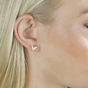 Noemi Mini Triangle 18ct Stud Gold Earrings Side View On A Models Ear