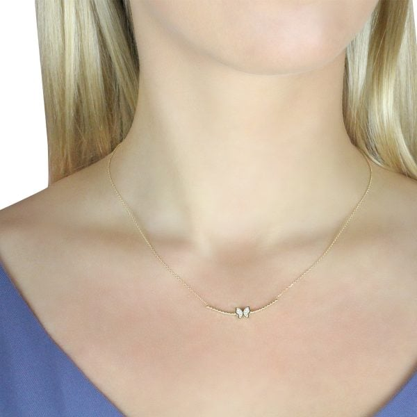 Gia Butterfly Gold Pendant Necklace On A Models Neck