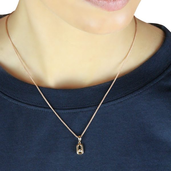 Cali Mini 18ct Rose Gold Pendant Charm With A Gold Chain Around A Models Neck