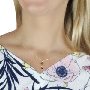Noemi Key 18ct Gold Pendant Charm Vintage Design With A Gold Chain Around A Models Neck